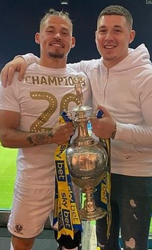 Phillips and his younger brother celebrating Leeds winning promotion in 2020