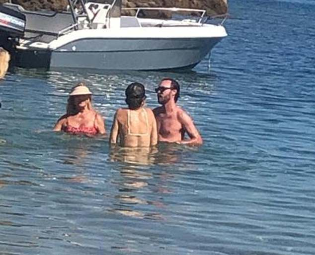 Relaxing trip: Kate, Goldie and Danny lingered in the warm sea as they stood around laughing and chatting
