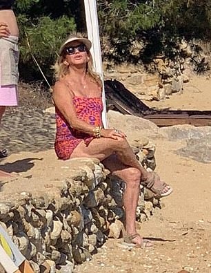 Family getaway: Basking in the Mediterranean sun, Kate Hudson and her beau Danny Fujikawa are pictured with Goldie Hawn and Kurt Russell on a family holiday in Greece
