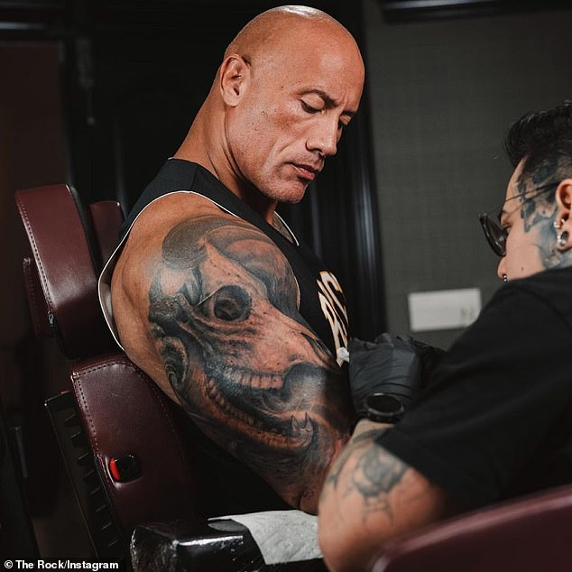 Extensive work: Dwayne 'The Rock' Johnson gave an update on the extensive work he's having done on his bull bicep tattoo over the weekend