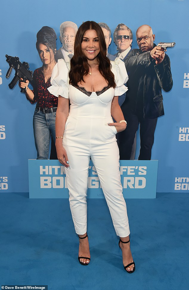 Stunning: Model Imogen Thomas donned an all white ensemble in a crisp jumpsuit with a plunging lace neckline