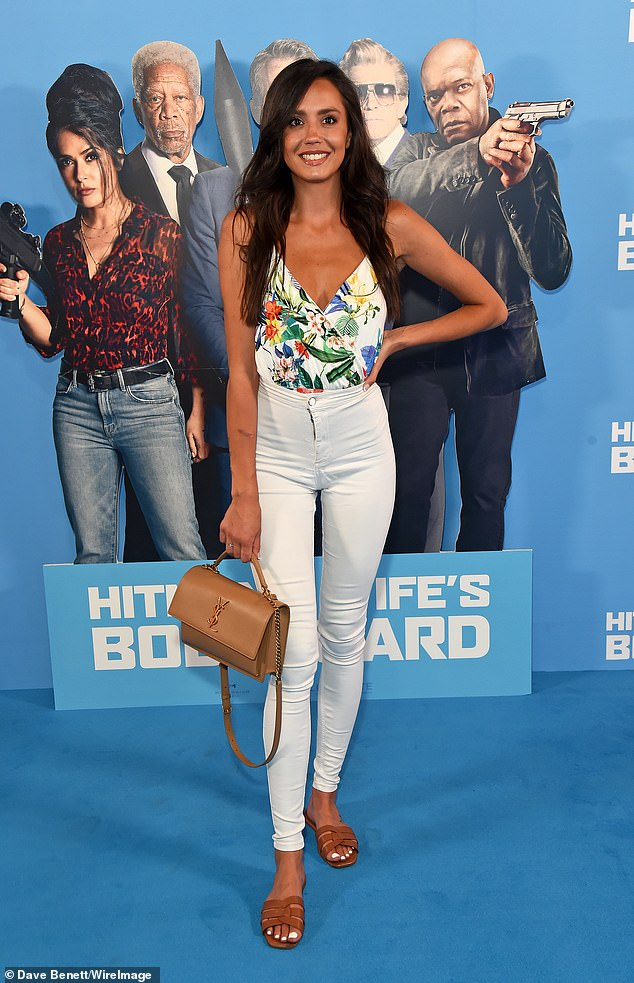 Summer ready: Love Island's Tyla Carr opted for a laidback look and donned white jeans and a plunging floral vest top