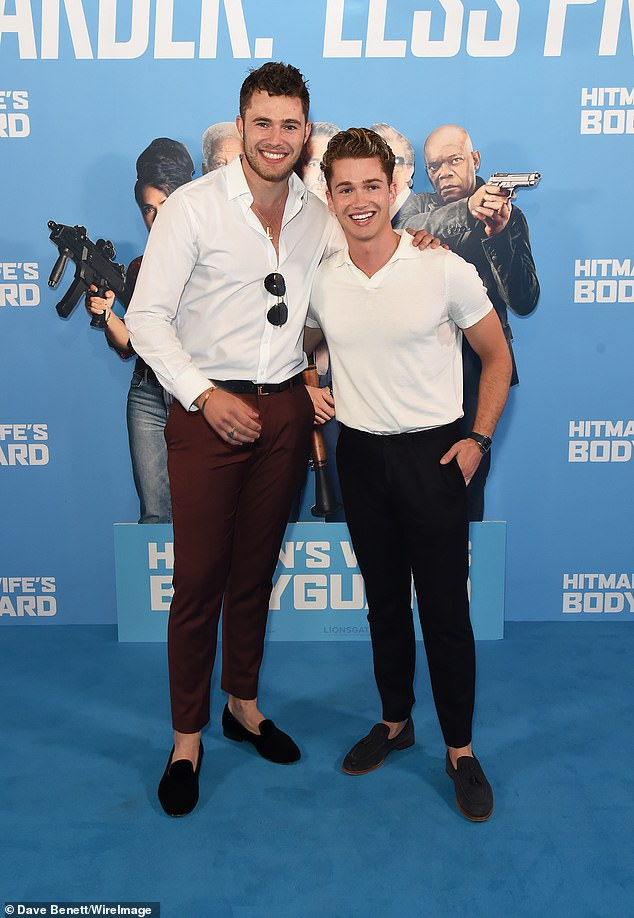 Sibling outing: Curtis and AJ Pritchard cut dapper figures in chinos and suede shoes as they took to the blue carpet