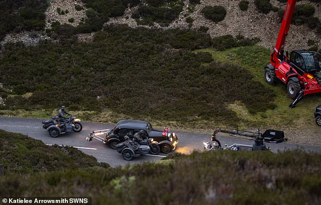 Aerial view: The cars and bikes zoomed along the country lane