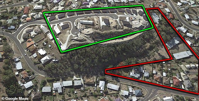 Tasmania's worse development? Eight homes in McGill Rise (inside the green box) were evacuated after fears the embankments posed an 'intolerable risk' of collapse. Other homes are under threat from falling boulders and debris below (red box)