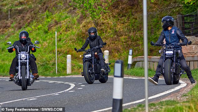 Three's company: The riders were seen burning rubber down the quiet streets of Glencoe