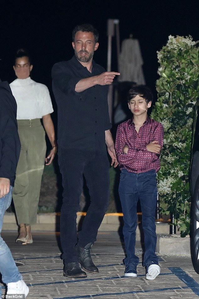 How sweet:After the family gathering, Ben seemed to be pointing Max in the right direction as the youngster looked exhausted