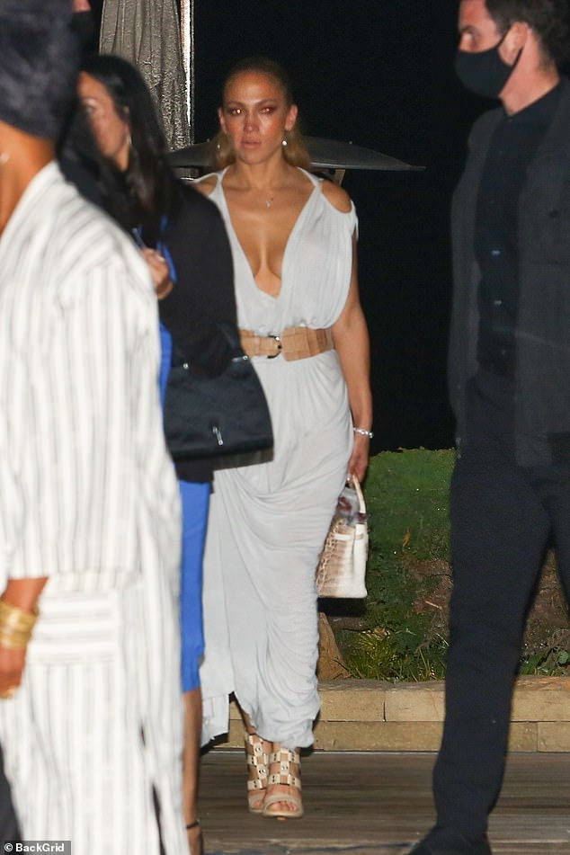 Va va voom: JLo's cleavage was on full display as they left the restaurant