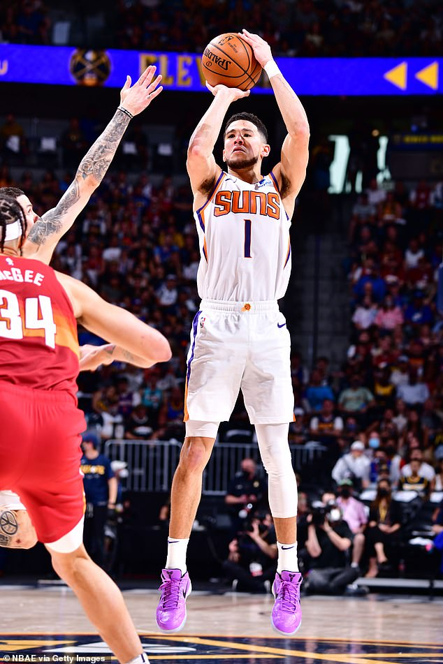Approved!  Devin, who plays for the Phoenix Suns, also reportedly got the approval of the entire Kardashian-Jenner clan, the source adding: his whole family loves Devin 'too;  Devin pictured on June 13