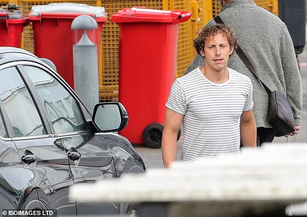 Outside: Meanwhile, husband Paul was seen arriving on the set of EastEnders in Elstree in a casual ensemble