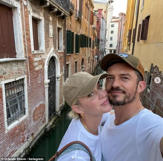 Updates: Earlier Wednesday, Orlando also enjoyed candid snaps on his own Instagram from their getaway captioned: '[pizza] discharge and a kiss under the bridge for good luck. '