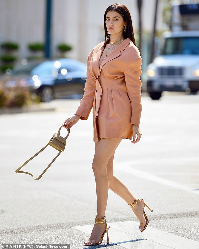Dressed for success: The former WAGS wore a coral pink blazer dress and a pair of stilettos as they strolled through the busy city streets