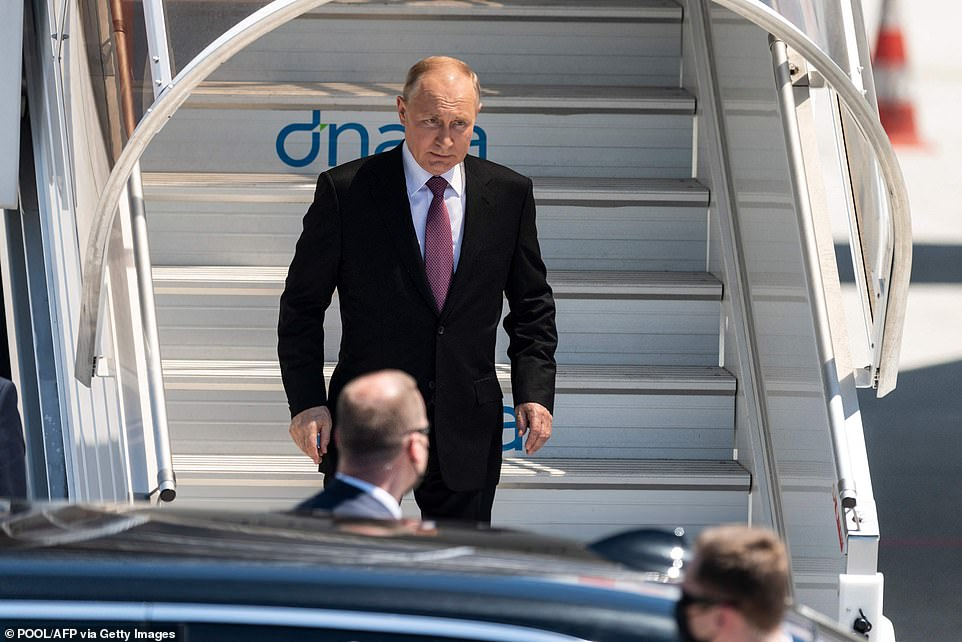 Putin quickly exited the jet stairway and joined his motorcade, offering a quick wave