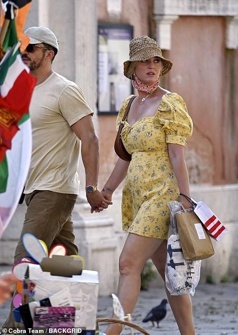 Treat yourself: Katy enjoyed some shopping with Orlando