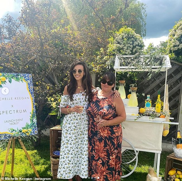 Like mother like daughter: The soap star, 34, looked radiant in a white floral dress, with an off-the-shoulder neckline, to promote her new line with Spectrum Collections