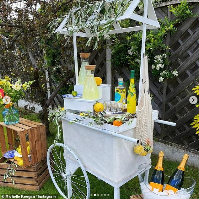 Expensive taste: Next to the cart, a cooler was placed on the ground with two Veuve Clicquot bottles