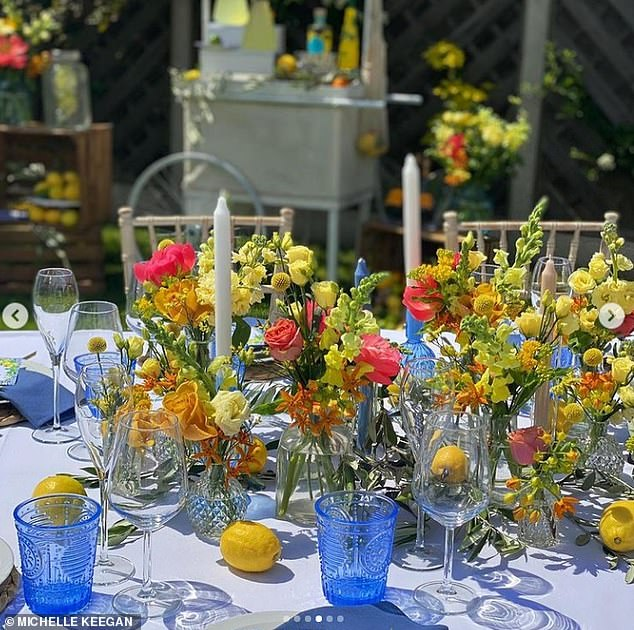 Chic: The outdoor table featured vases filled with summery flowers, candles, and an elegant dining set-up