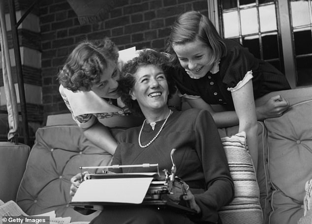 Enid Blyton with her two daughters Gillian (left) and Imogen (right) at their home in Beaconsfield, Buckinghamshire