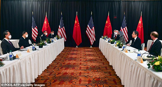 Anthony Blinken, the Secretary of State (center right) is seen meeting his Chinese counterpart in Alaska on March 18. At the meeting, Dong's defection was raised, a Chinese dissident has alleged. China asked for Dong to be sent back: Blinken reportedly refused