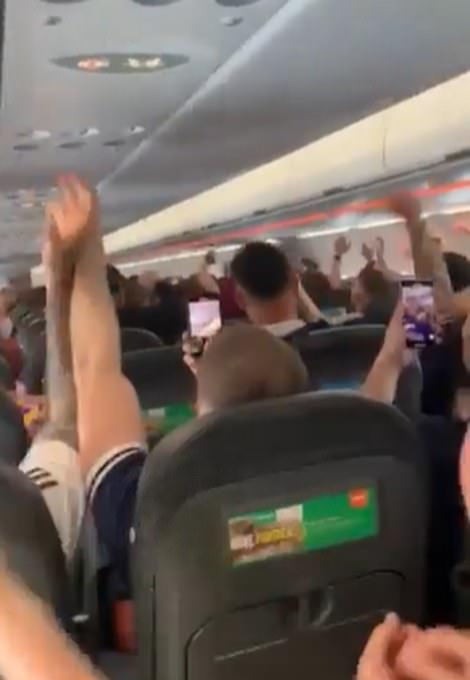 Fans were singing on a plane to London