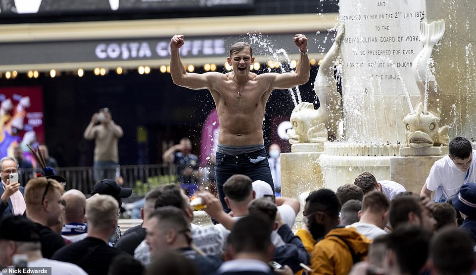Scottish Football supporters in jumping in the fountain at Leicester Square ahead of the Uefa clash yesterday
