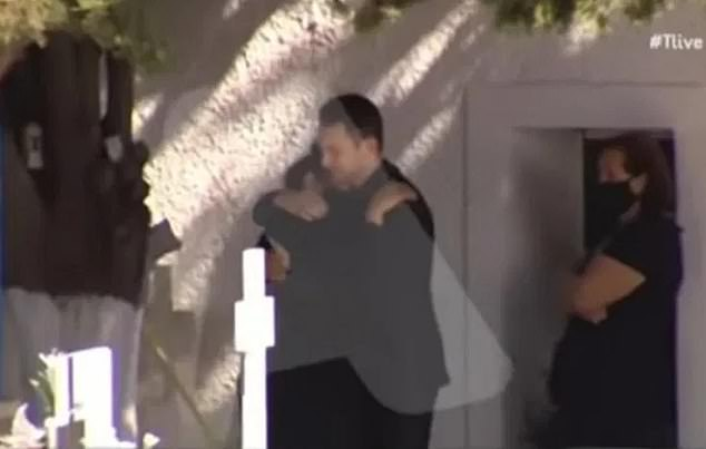This is the moment BabisAnagnostopoulos hugged the grieving mother of his dead wife at her memorial service - just hours before he confessed to being her killer