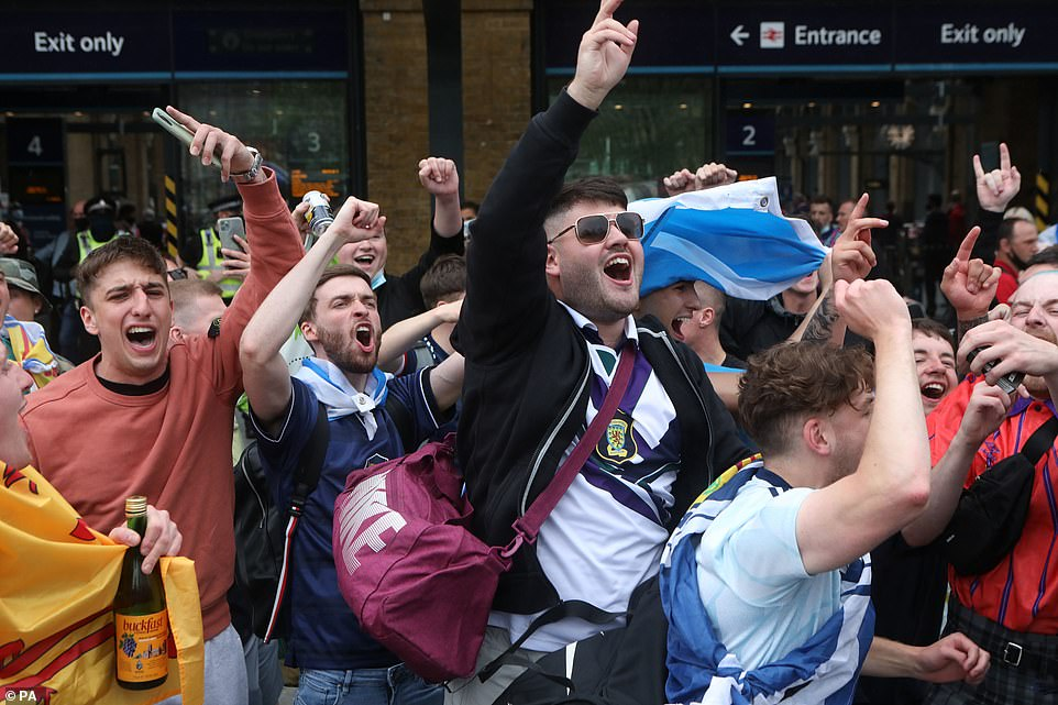 Scotland fans arriving at King's Cross station show their support today in London ahead of the UEFA Euro 2020 match