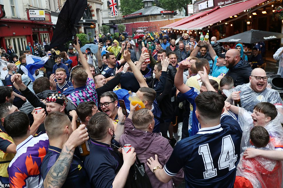 Scotland fans gather in Leicester Square today before the UEFA Euro 2020 match between England and Scotland later