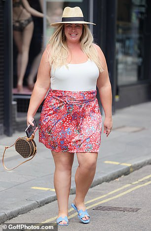 Designer garb: The television personality teamed her summery look with blue Hermes sandals and a Louis Vuitton clutch bag