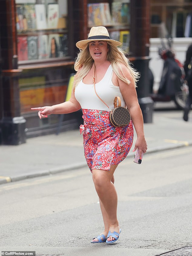 Cheery: Gemma appeared in great spirits as she flashed a wide smile at photographers while strutting through the streets of Soho