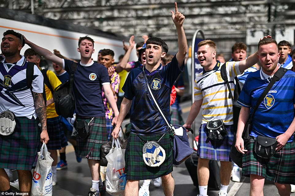 Scotland football supporters gathered at Central Station before boarding trains to London on June 17