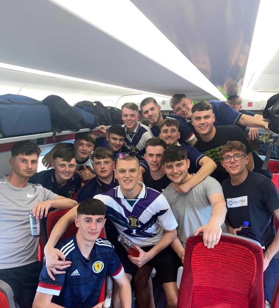 Scotland fans are seen posing on board a flight yesterday heading into Londonahead of the Euro 2020 clash at Wembley
