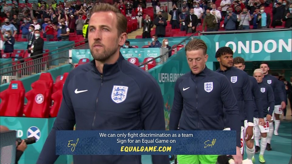 Harry Kane leads the England stars such as Jordan Pickford behind him out onto the soaking wet turf at Wembley for the match