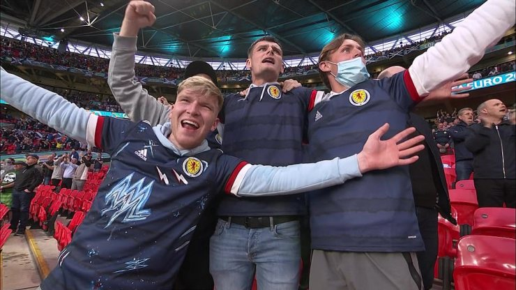 Scotland fans donned in their national kits are some of the lucky few to get tickets to Wembley in north London on Friday night