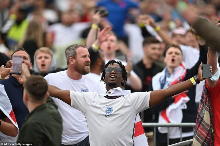 England supporters prepare to cheer on their team at the 4TheFans Fan Park in Manchester as the match got underway on Friday night