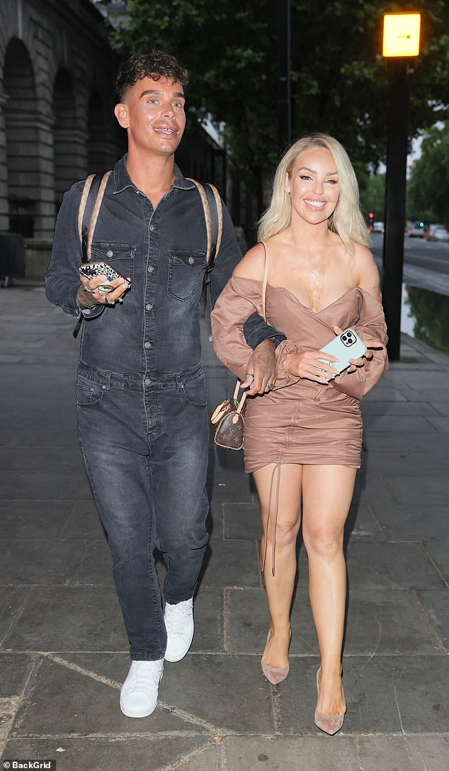 Night out:And Katie appeared to be having a whale of a time as she attended the event with a male friend who was seen wearing a denim jumpsuit