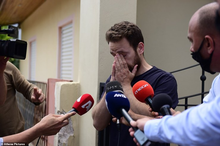 Anagnostopoulos weeps as he speaks to reporters outside the family home in Athens after the murder, saying he did not know his wife was dead until police arrived and took his blindfold off
