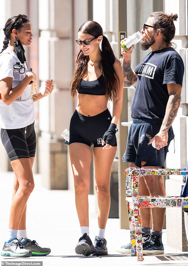 Sporty: Hadid wore skimpy black Gotham shorts, a matching sports bra, and sneakers for her workout which was centered around boxing, also known as the sweet science