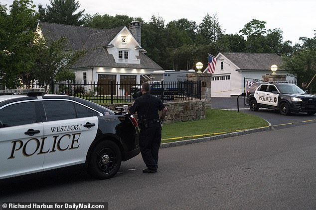 Police investigate the crime scene. where a Connecticut mom, 46, drowned her seven-year-old daughter at her $1.8M Connecticut mansion before taking her own life