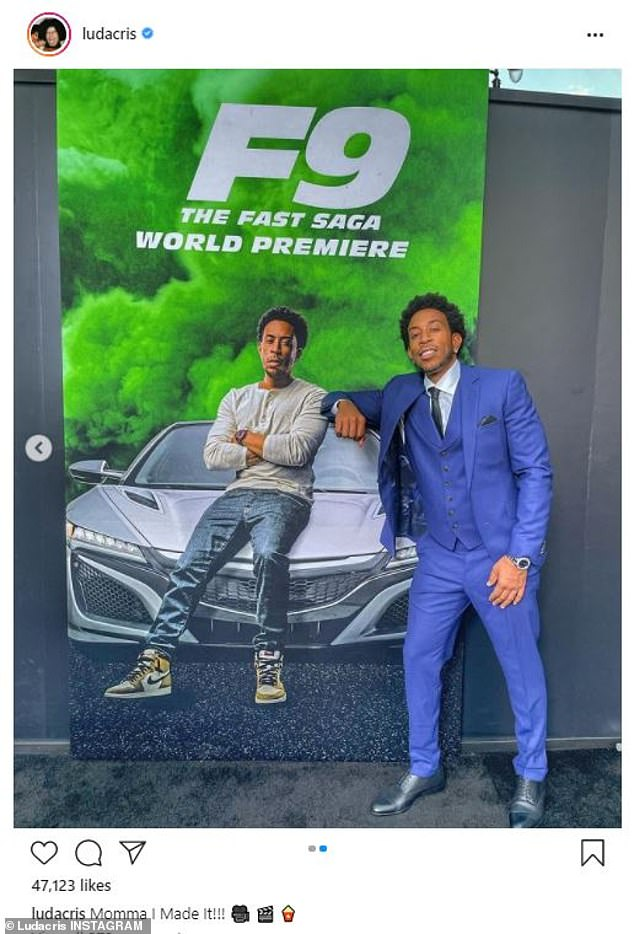 Strike a pose: Posing in front of the F9 poster featuring his character Tej, the entertainer looked gleeful: On Instagram post he added the caption, 'Mama, I made it!'
