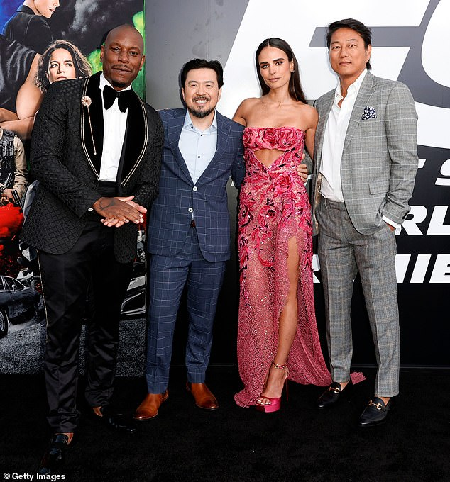 The boys: She was joined on the red carpet by her costars Tyrese Gibson (L) and Sung Kang (R), as well as director Justin Lin, who returned after two films away from the series