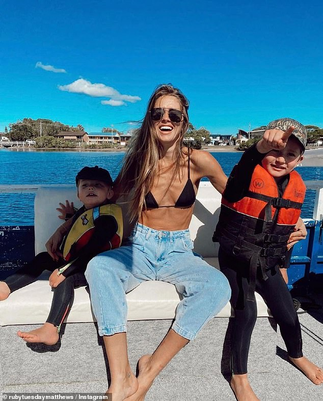 Mother: Ruby is a doting mother to two sons - Rocket, four, and Mars, three - with pro surf photographer ex Ryan Heywood