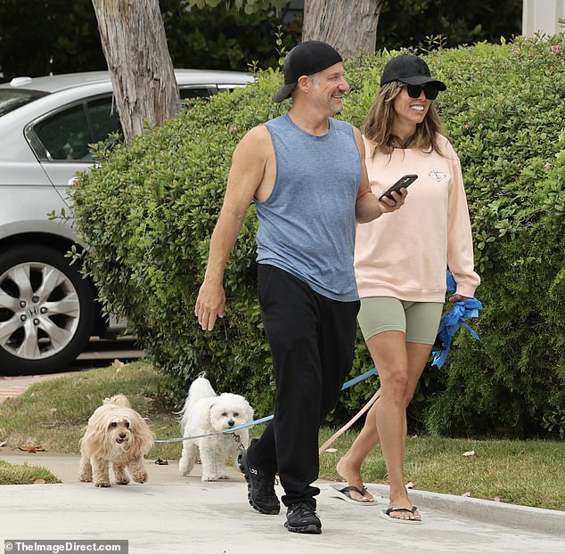 Walking mutts: The TV personality, 45, smiled alongside her husband Leventhal, 61, who also quit his job as Fox News correspondent this week