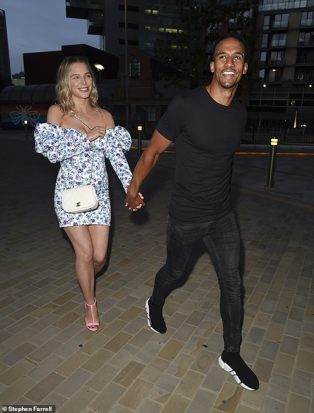 In love: The former Coronation Street star, 30, and her footballing fiance, 32, beamed as they walked towards the Manchester menagerie while holding hands