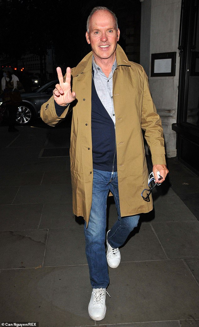'Peace': Michael Keaton appeared to be in high spirits on Saturday as he donned casual attire for dinner at a hotel in London