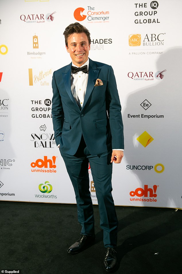 Suave: Meanwhile, weather anchor James Tobin looked super suave in a blue suit, which he paired with a Dickie bow and patterned clutch