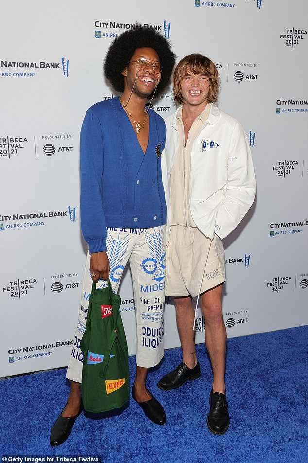 Smiling: Jordan also posed with actor Jeremy O. Harris, who wore a blue double-breasted cardigan as part of an eclectic ensemble