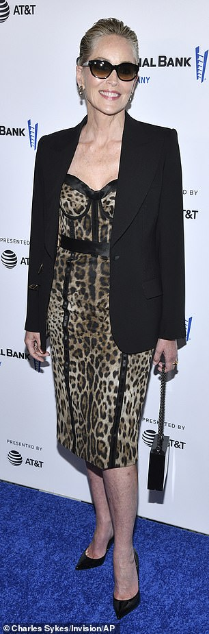 Class: Actress Sliver, 63, looked stylish in a black blazer and leopard print dress, with black piping reminiscent of a corset