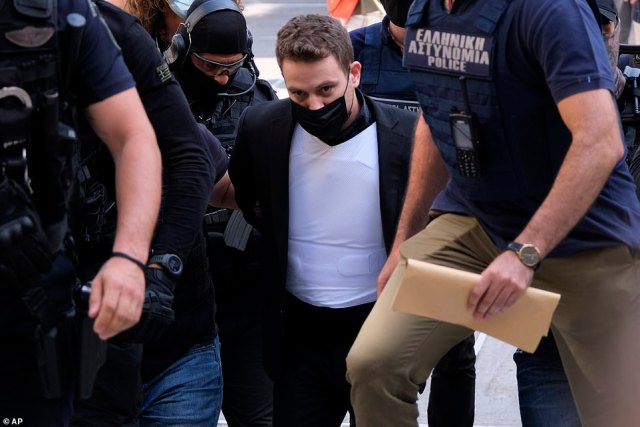 Babisarrives in court in Athens to be charged with the murder of his wife and their pet dog after police say he confessed