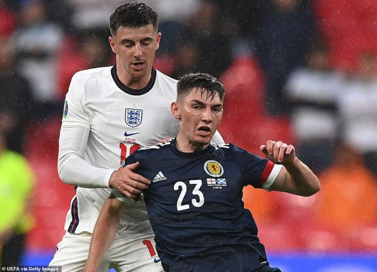 Gilmour (right) was named man-of-the-match after the draw at Wembley and his absence is a huge blow for Scotland